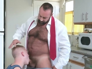 The son helping daddy getting ready for work